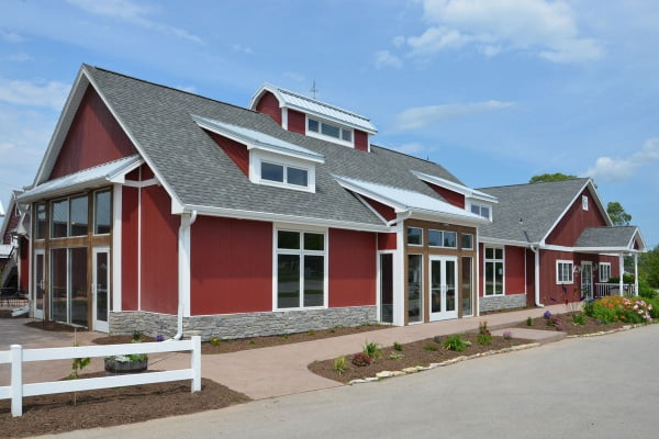 Diamond Kote® Grooved Panel Siding in Cinnabar with Trim in White